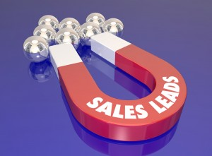 Sales Leads words on a red 3d magnet to illustrate lead generation activity to bring in new customers and prospects
